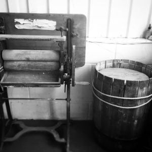 Old mangle and wooden barrel in the brewery